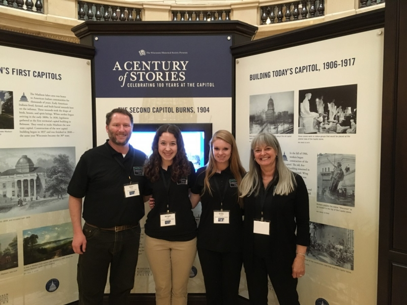 Delegates Brian Kelsey and Catherine Pabich with two student delegates from Kewaunee County, checking out the history displays at the Capitol.